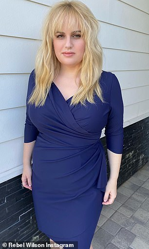 Blue beauty!  In August, Rebel showed off her slimmed down physique in a tight blue wrap dress on Instagram (pictured)