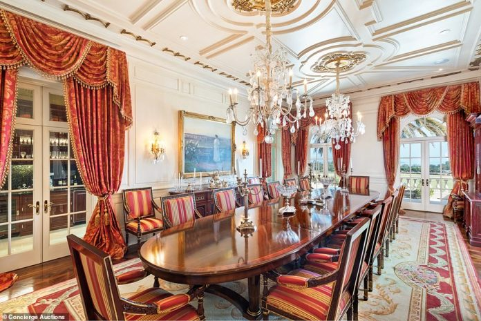The main dining room is decorated more traditionally with chandeliers and red drapes, next to a large open kitchen for ease of serving
