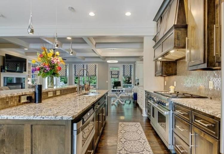 Marble: The 2,600 square foot home set in a gated community also includes a lavish great room, a gourmet kitchen, an elevator and two guest suites with private baths