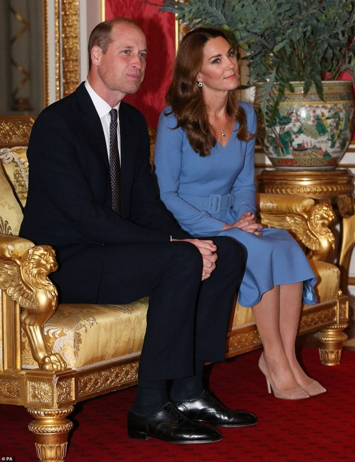 The Duchess of Cambridge looked elegant in a cornflower blue belted dress, thought to be by designer Emilia Wickstead
