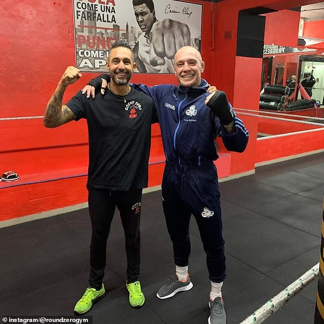 Conor McGregor continued his training at a gym in La Spezia with gym owner Luca Riccardi (L)