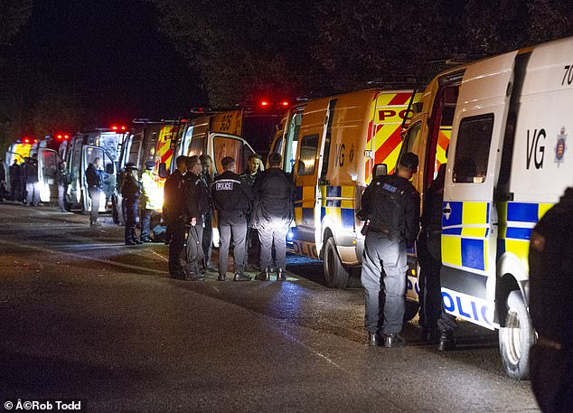The gang was rumbled when police (pictured at the dawn raids) received a tip-off about suspicious drug activity in a pub run by the alleged ringleader
