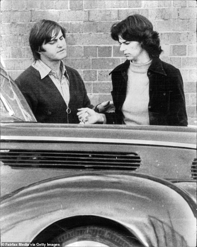 Johnny Regan is pictured outside Darlinghurst police station in 1974 with the mother of three-year-old Karlos Scott-Huie who police believe Regan murdered