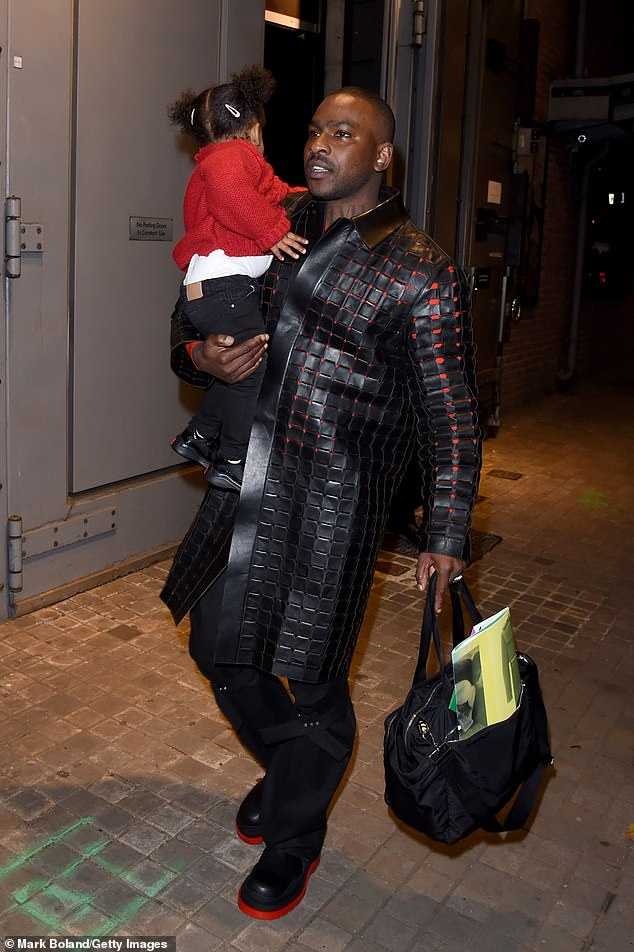 Cool: Skepta paired the jacket with black pants that complemented her chunky red-soled boots