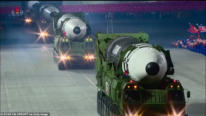A screen grab taken from a KCNA broadcast on October 10, 2020 shows North Korean Hwasong-15 intercontinental ballistic missiles during a military parade today