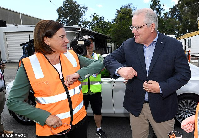 Deb Frecklington (left), Queensland LNP Chief Executive Officer, greets Prime Minister Scott Morrison upon arrival for a tour of Neumann Steel Fabrication on the Gold Coast on October 10th