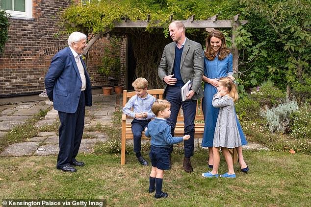 The Duke and Duchess of Cambridge stand