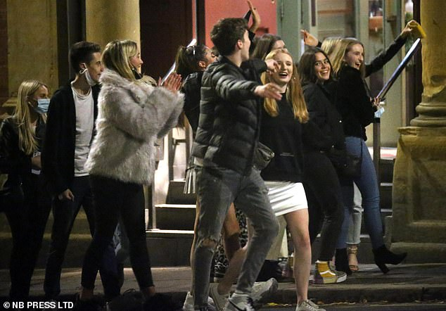 Revellers - some with protective face masks - were seen enjoying their night out in Leeds