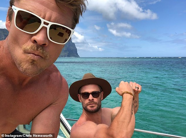 Check out the arms exhibition! He also posted a number of photos from the trip, including a picture of himself showing his bulging biceps with his older brother Luke on a boat off the island's coast