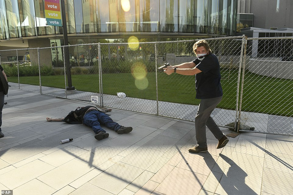 Dolloff turned and looked toward the camera after shooting Keltner at 3.37pm on Saturday outside the Denver Art Museum