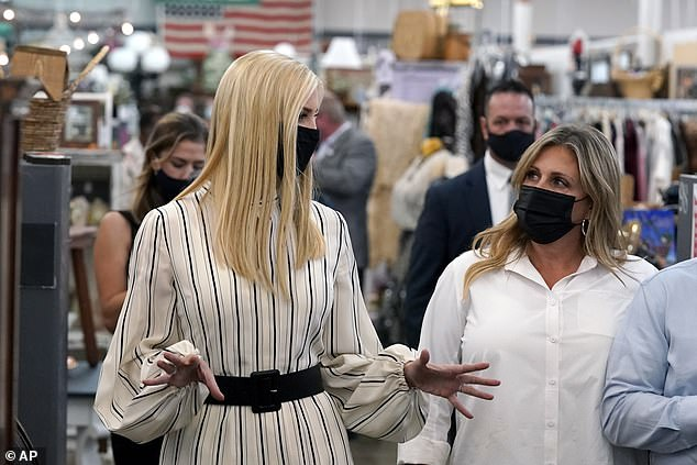 Ivanka Trump, left, daughter and advisor to President Donald Trump, speaks to business owners as she visits American Way Antiques
