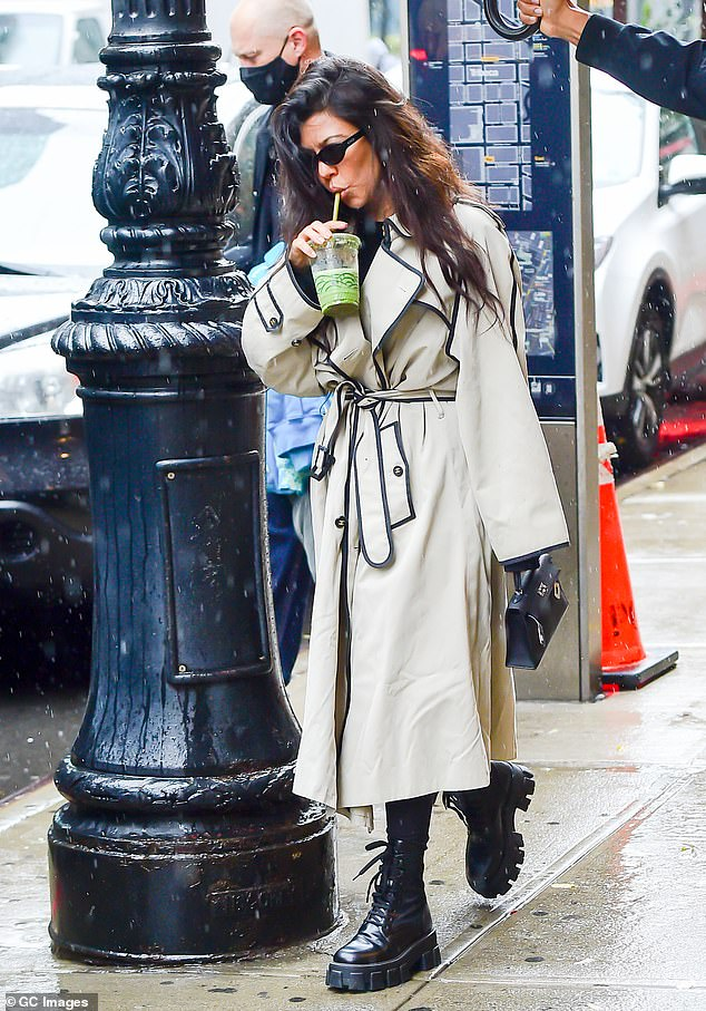Fashion: Kardashian-Jenner brood elder kept her figure hidden in a long beige coat and wore chunky black boots