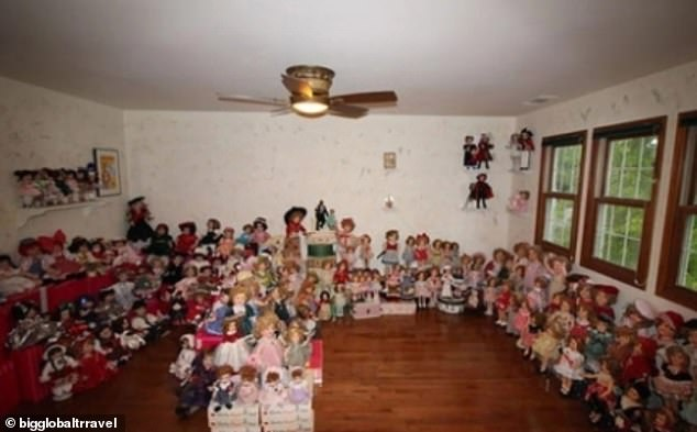 Estate agents from around the world have been sharing snaps online of some of their most bizarre listings (pictured, one person who uncovered a room packed full of dolls)