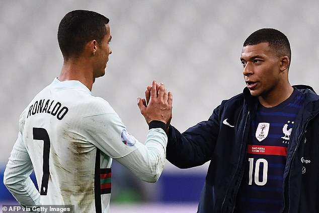 Ronaldo touches Kylian Mbappe at the end of Portugal's game with France on Sunday night