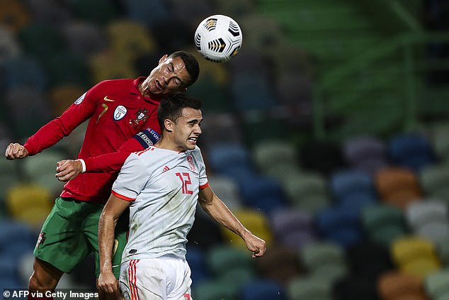 Four days before the game against France, Ronaldo was in the thick of the action in a friendly against Spain, seen here defying a header against Tottenham Hotspur's Sergio Reguilon.