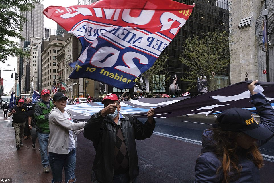 The group unveiled the flag over the controversial Black Lives Matter mural on Fifth Avenue