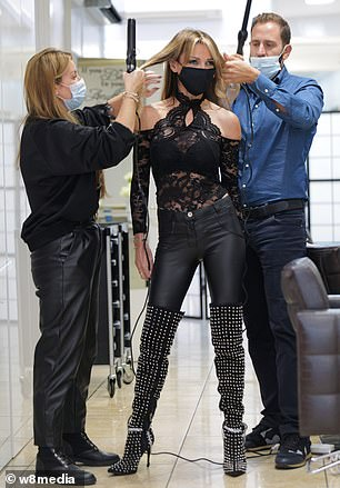 Wow! She proudly displayed her svelte physique in the black lace off-the-shoulder blouse