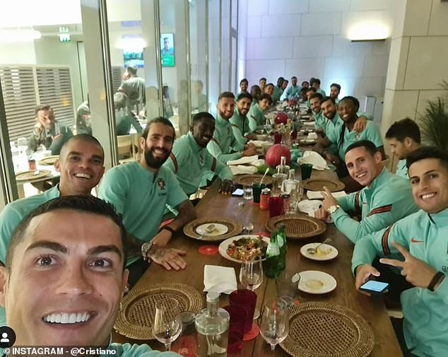 Hours before: Ronaldo (bottom left) posed for a photo with his team-mates just hours before the news broke