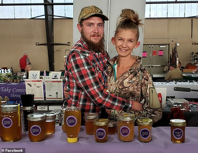 Dolloff's Facebook page and public records reviewed by DailyMail.com show that he runs his own business in Elizabeth, Colorado, called Lavender Moon Farm, where he raises livestock and bees with his wife. Pictured: Dolloff and his wife sell their honey products at a trade show in March 2019