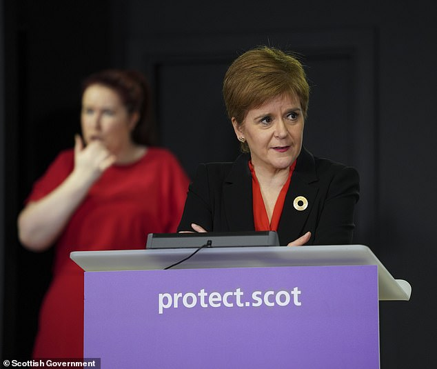 The drastic restrictions come after Nicola Sturgeon (pictured today) suggested she is also considering a ban, and warned Scots not to travel to Blackpool because 180 cases north of the border had been linked to the seaside town recently