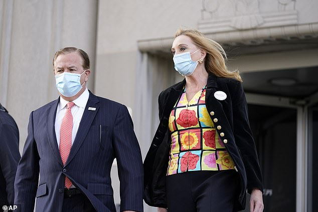 The McCloskeys declined comment after Wednesday's hearing. Pictured leaving court after entering their not guilty pleas