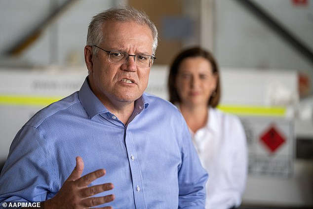 Mr Morrison (pictured on Wednesday) said: 'There will still be, for the foreseeable future, restrictions on Australians leaving the country'