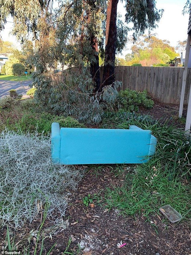 A couch was left in the front garden of Chris Taranto's rental property