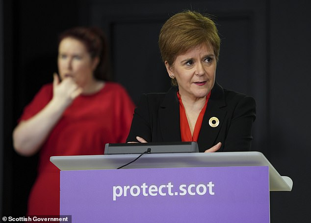 Nicola Sturgeon (pictured yesterday at a press conference at St Andrew's House in Edinburgh) said she wants all parts of the UK to restrict travel from areas with the highest number of cases