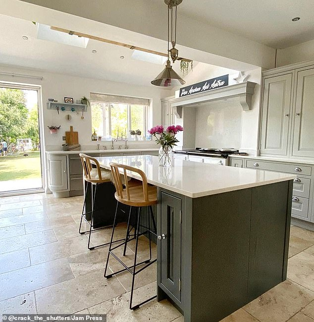 A large breakfast bar gives the family extra space for eating and preparing food
