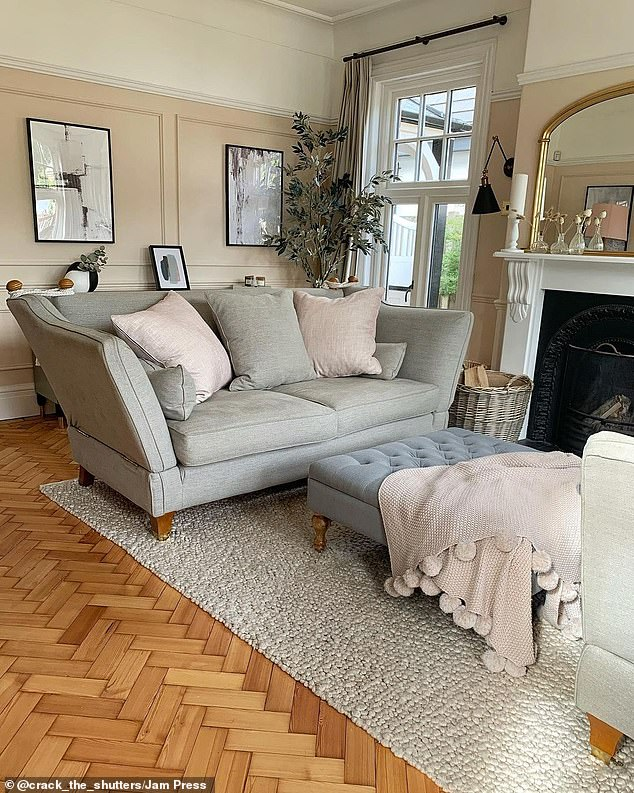 Soft furnishings and rugs create a homey feel in this beautiful living space