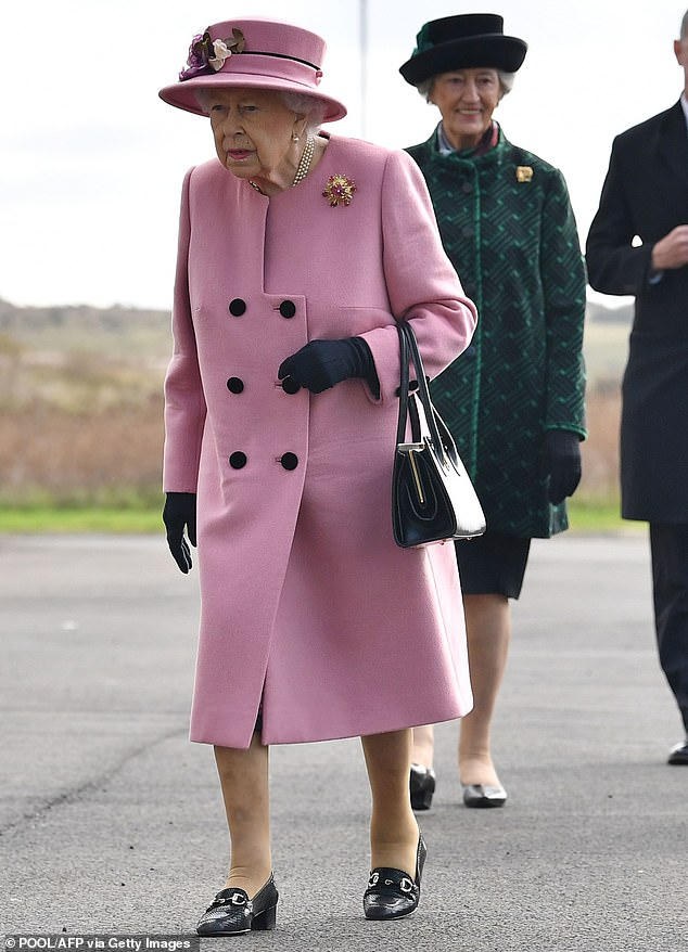 The Queen donned a blush pink coat as she ventured out of HMS Bubble today, for a trip to the Energetics Analysis Centre at Porton Down science park near Salisbury