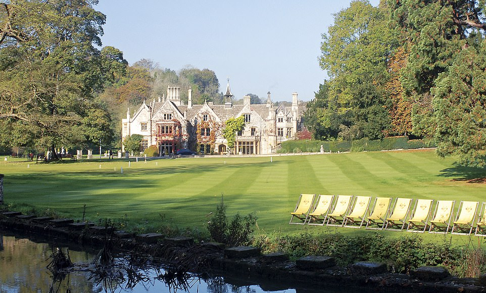 The Manor House hotel in Wiltshire sits in manicured grounds by the Bybrook River, in the foreground in this image