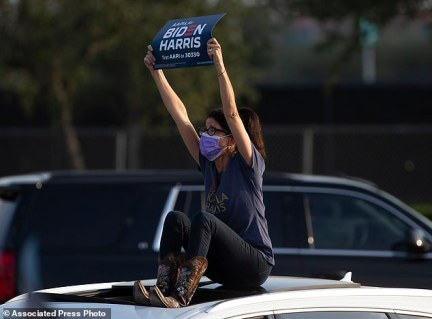 A supporter holds up a sign during a get out the vote event featuring Jill Biden, wife of Democratic presidential candidate former Vice President Joe Biden on Tuesday