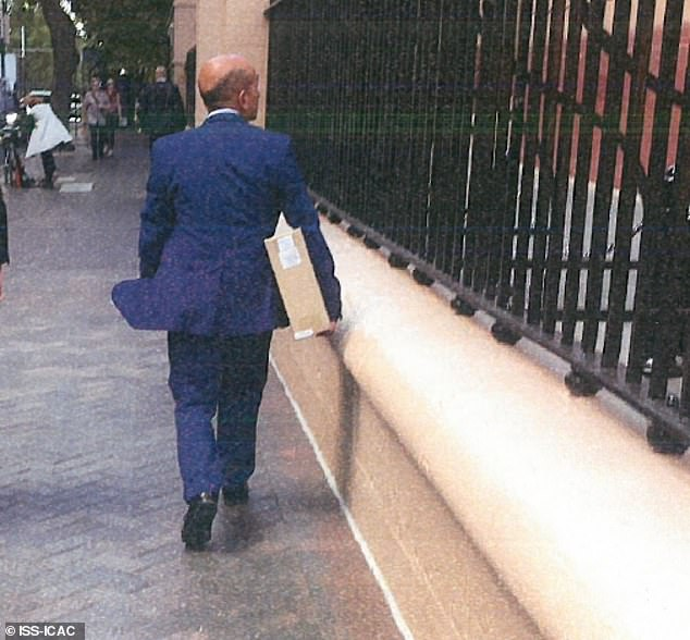 Sydney property developer Joseph Alha is covertly photographed as he arrives at NSW State Parliament on November 15, 2017 - the day he had a 'drop in' meeting with Gladys Berejiklian