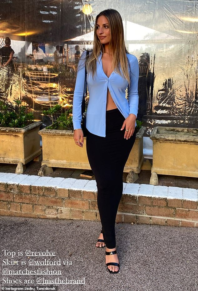 Chic: EElsewhere on her Instagram, she showed off her entire outfit - the blue button-up top, matched with a figure-hugging bodycon dress that she wore as a midi length skirt