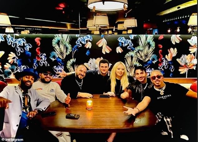 At the steakhouse on Monday, she took a smiling photo with Einhorn, rapper Slim Stunta, club promoter Purple Miami, and entertainment agent Prince Fred