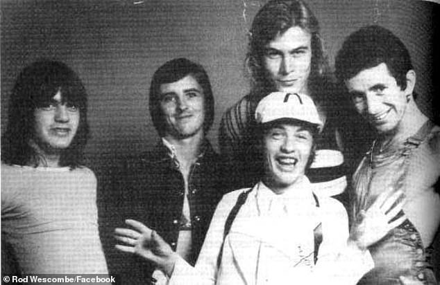 Pictured are Malcolm Young, Phil Rudd, Paul Matters, Angus Young and Bon Scott in the band's early years