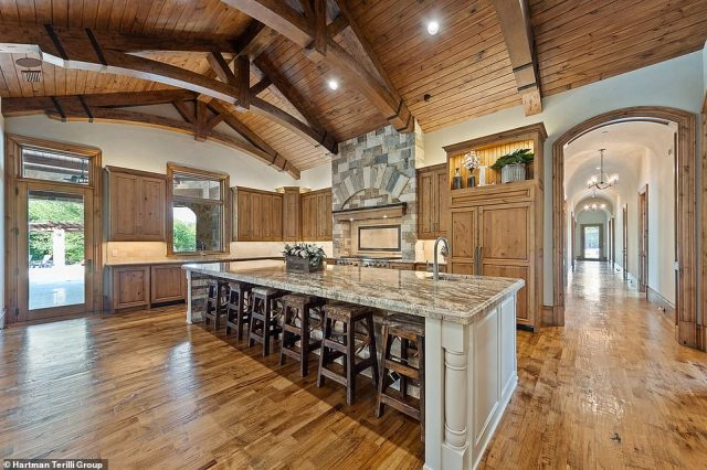 The cavernous but cozy kitchen has a huge central island and two dishwashers. The alderwood cabinetry gives the space a rustic feel
