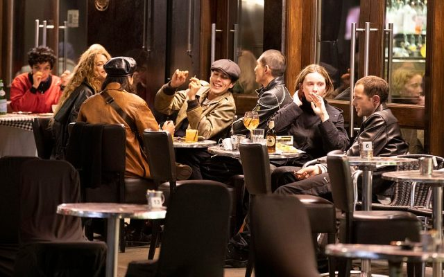 A group of six people sit outside a bar in London after mayor Sadiq Khan made a deal with ministers to tighten restrictions in the capital