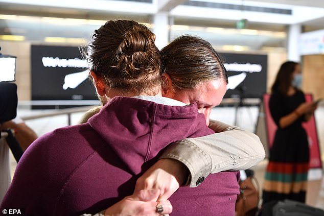 New South Wales Tourism Minister Stuart Ayres described the Sydney airport like 'living in a scene from the movie Love Actually' (there is no suggestion these are the travellers who went to Victoria)