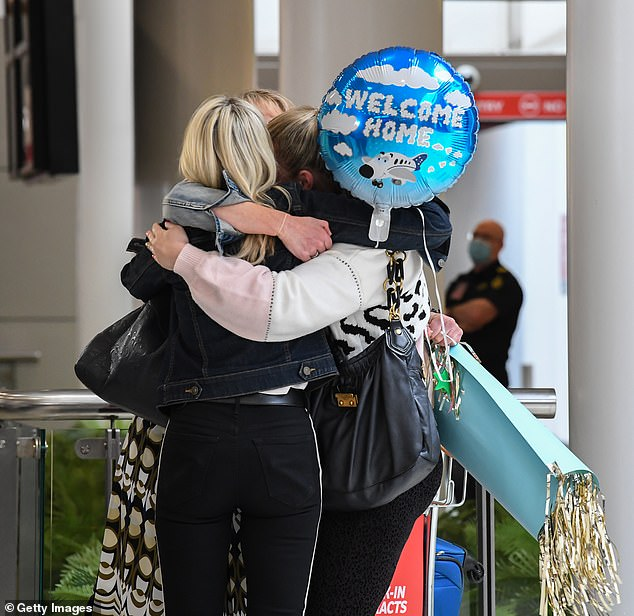 Friends hug at Sydney Airport on Friday - the first day of thetrans-Tasman travel bubble