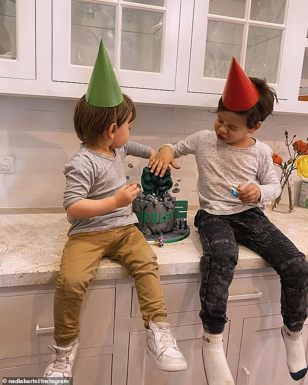 Fun!Nadia shared photos and a shot clip of Henley and his brother Aston, four, wearing party hats in the kitchen, to Instagram on Friday