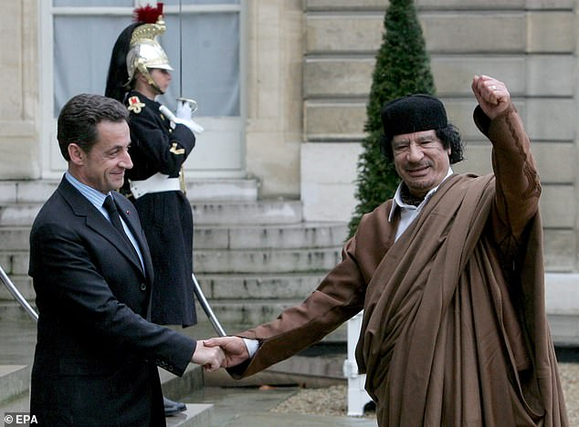 Nicolas Sarkozy has been charged with conspiracy over claims he funded an election campaign with cash from Libya's late Colonel Gaddafi (pictured together in 2007)