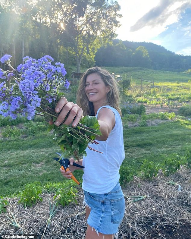 Flower power: She stopped to pick some lovely purple flowers to add a splash of color to her day