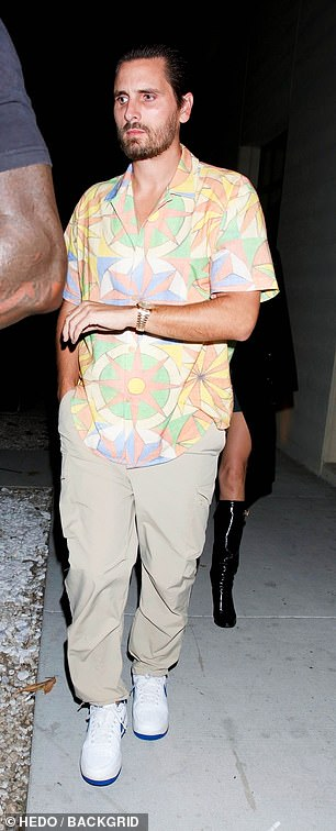 Out and about: Disick wore a colorful shirt with beige cargo pants on the outing but didn't seem to want to be photographed