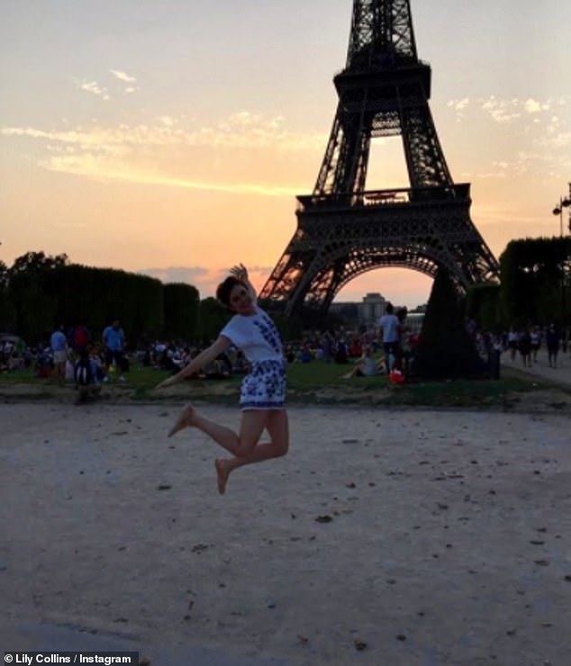 Throwback Thursday! Lily Collins shared a fun throwback snap posing in front of the Eiffel Tower on Thursday taken before her Netflix show Emily In Paris