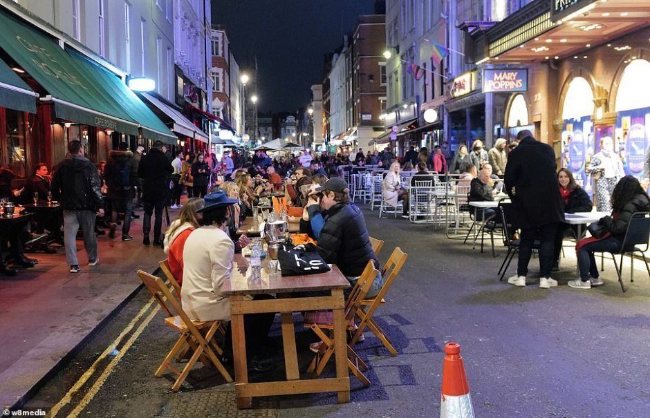 London's west end was teaming with life as people headed out to enjoy a final night of drinking before toughter restrictions come into force tomorrow