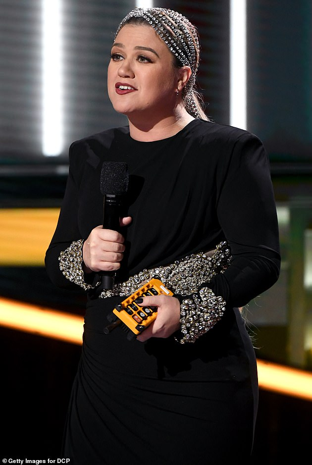 Supportive friends: His fellow The Voice judge Kelly Clarkson, 38, who hosted the awards show, also gave them a special shoutout: 'Our hearts go out to you both in this very difficult time and I'm thankful that you continue to share your light and your talent with all of us'
