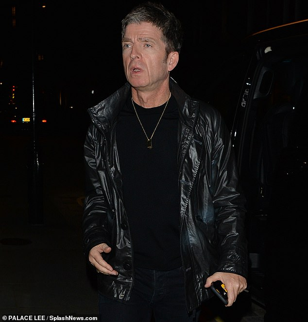 Social outing:The Oasis rocker, 53, looked effortlessly stylish as he entered the swanky eatery to meet with friends