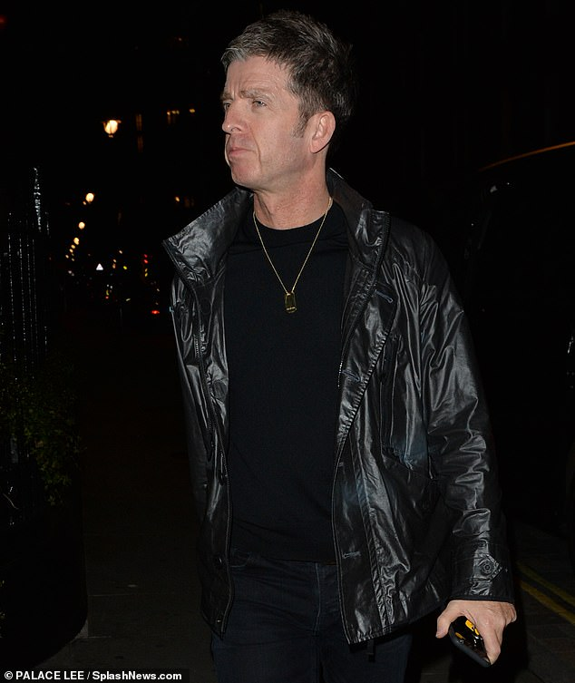 Back in black: Noel paired his black tee and skinny jeans with a rain jacket as he embraced the cold autumn weather
